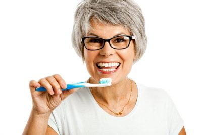 dental care and your health senior women toothbrush olympic dental & denture